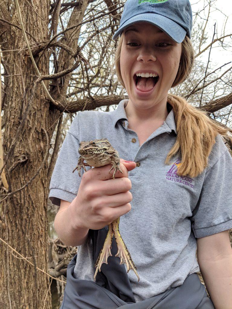 Emily Davis holding a Plains Leopard Frog